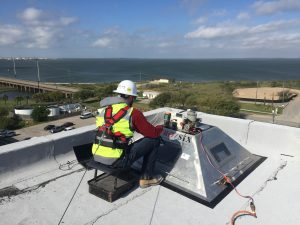 Z6 Commissioning performing roof membrane uplift resistance testing